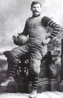 Abraham Strubu Jr. with the first football.  Ever.